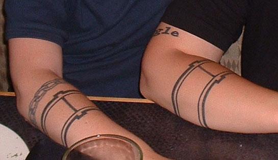 two arms, same tattoo